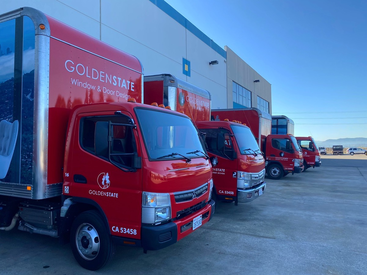 Red delivery trucks at Golden State Richmond