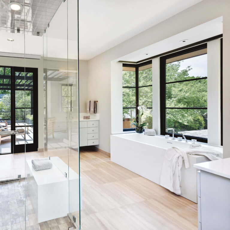 Brightly lit bathroom with Marvin signature windows