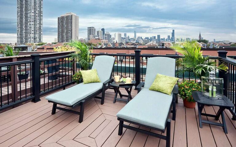 rooftop image with outdoor chaises longes on top of Trex escapes acorn enhance beach dune transcend decking
