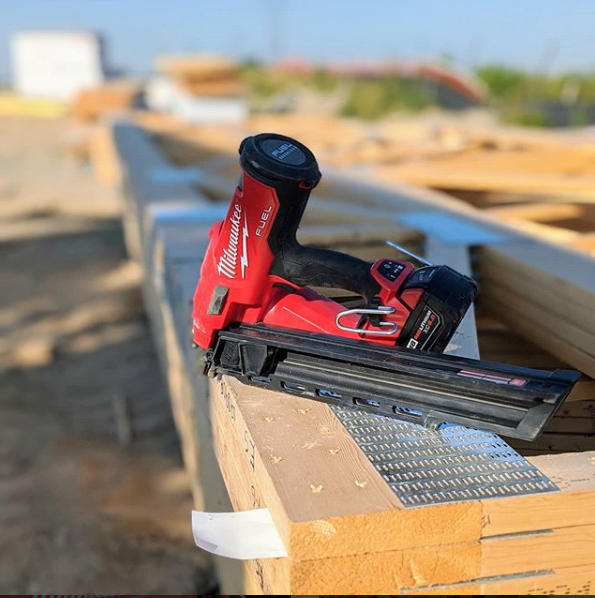 framing nailer on wood with milwaukee tools