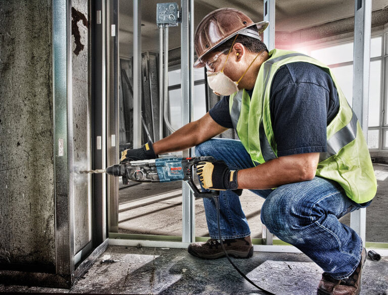 worker using Bosch drill