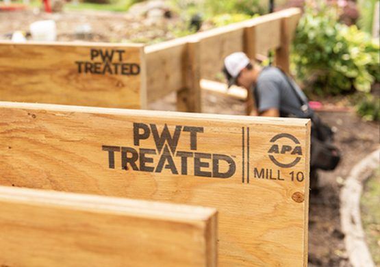 Pacific Woodtech PWI joist beams with worker